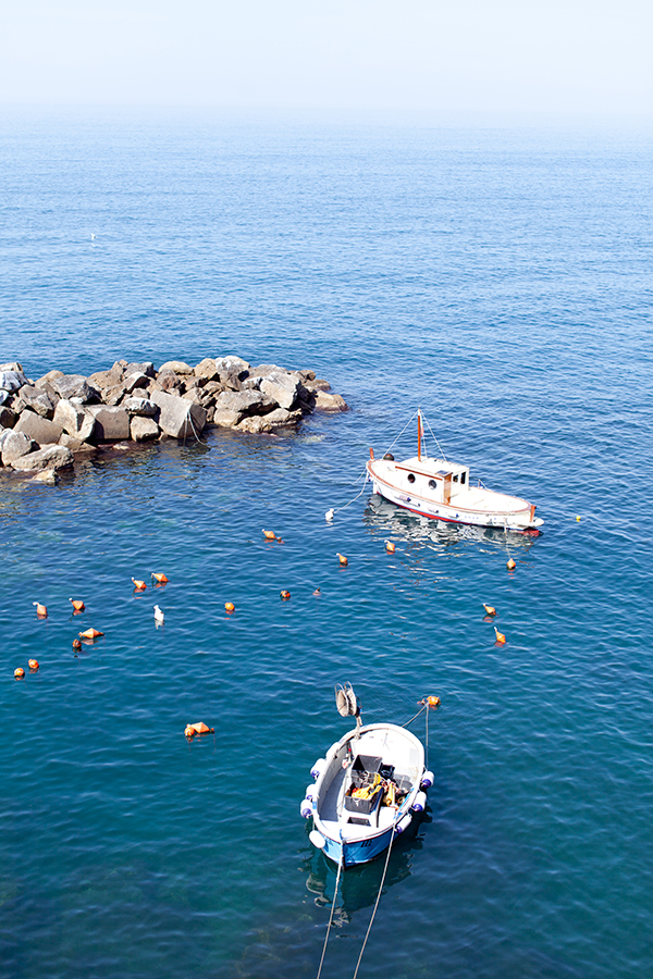 Boats in the Harbor of one of the Cinque Terre villages in Italy // WeAreAdventure.us
